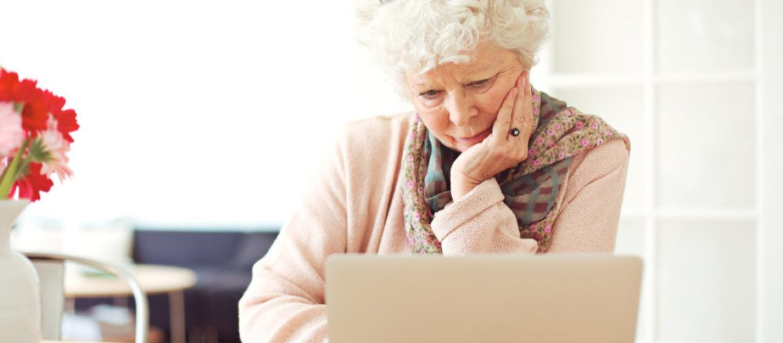 Senior Woman Busy Browsing Her Laptop